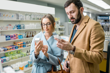Couple in the pharmacy store