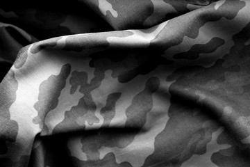Military uniform pattern in black and white.