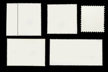 Set of old grunge posted stamp reverse side of different geometric shapes isolated on black background.Template for graphic designers
