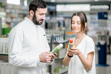 Pharmacist with client at the pharmacy store