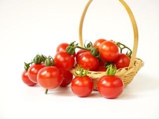 Tomatos in basket isolated on white background.