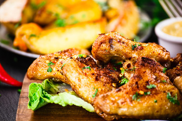 Roast chicken wings with baked potatoes