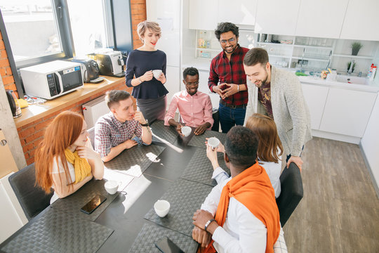 close up top view image of friendly startup team gathering around the table in lunch time