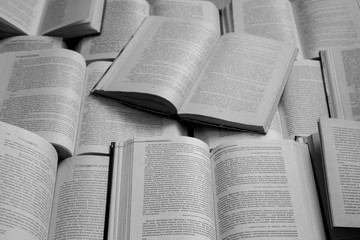 Open books top view black and white (monochrome). Library and literature concept. Education and knowledge background. Vintage books with text. Books with open pages. School and information concept.