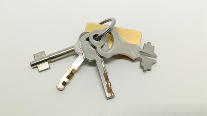 set of door and lock key on white background