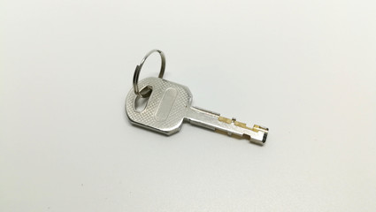 single of door or lock key on white background