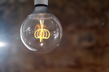 Modern LED lamp with a ball-shaped glass bulb design in retro style