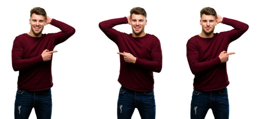 Handsome blond man pointing away side with his finger isolated over white background