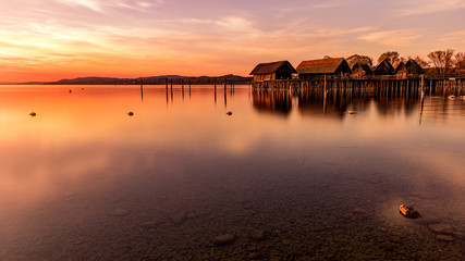 Colorfull sunset at Lake Dwellings of the Stone and Bronze Age in Unteruhldingen on Lake Constance, Baden-Wurttemberg
