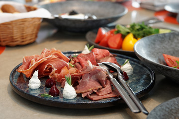 Assortment of cured and smoked meats and roast beef