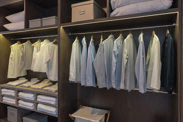 modern closet with clothes hanging