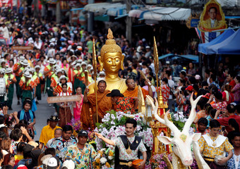 Thai-Mon people celebrate during the Songkarn parade, a part of Songkran Water Festival celebrations, to commemorate the Thai New Year in Bangkok