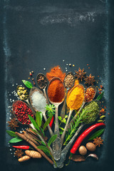 Wall Murals Spices Various herbs and spices on dark background