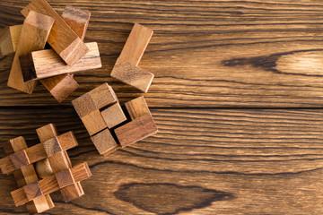 Assorted interlocked wooden puzzles