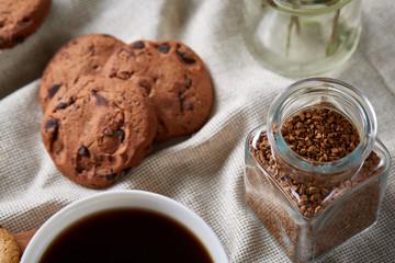 Breakfast background with mug of fresh coffee, homemade oatmeal cookies, grind coffee