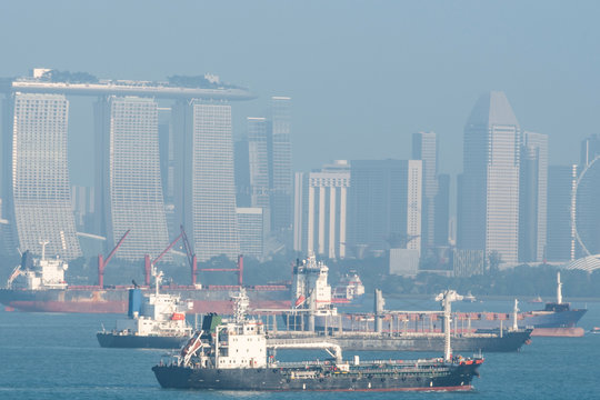 cargo ships and city of singapore