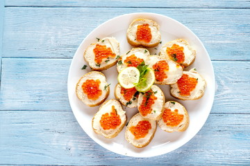 toasts with red caviar