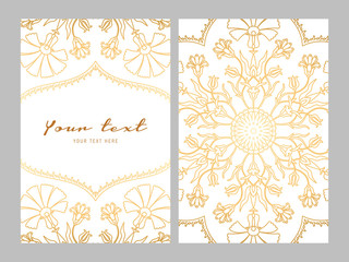 Greeting card golden ethnic patterns on white background