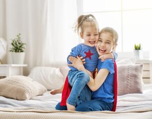 children playing superheros