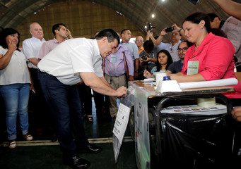 Paraguayan President Horacio Cartes casts his vote in a polling station during elections in Asuncion,