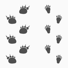 Animals footprints isolated on light background.