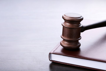 Judge gavel with book on wooden table