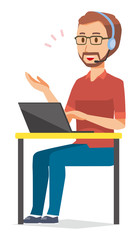 A bearded man wearing eyeglasses is talking on income