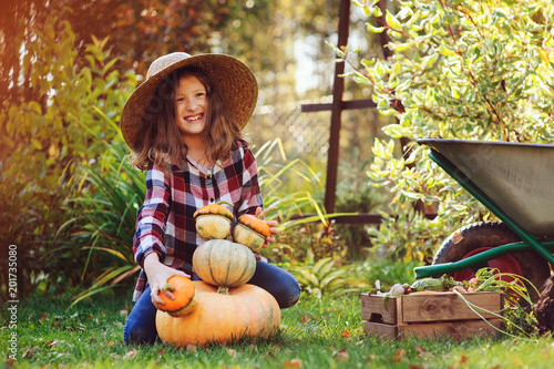Funny Happy Kid Girl Playing With Pumpkins And Building Snowman