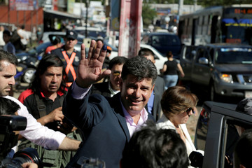 Paraguayan presidential candidate Efrain Alegre of GANAR coalition waves to the media after casting his vote in a polling station in Asuncion