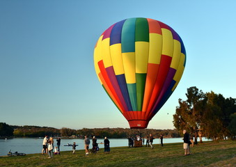 Canberra, Australia - March 11, 2018. Big colourful hot air balloon landed at Lake Burley Griffin, as part of the Balloon Spectacular Festival.