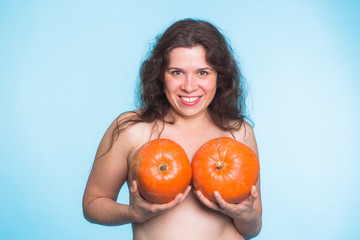 Plastic surgery concept - woman breast pumpkins implant upsize metaphor