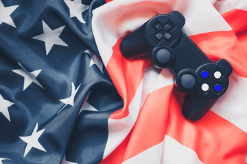 joystick on red and white stripes and white stars on blue. Patriotic mood. American flag. celebration of independence day on July 4th.