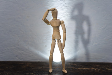 wooden toy in the image of a man on a white background