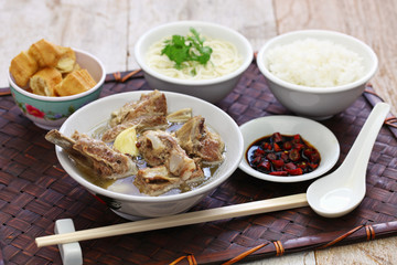singare bak kut teh, spicy pork rib soup isolated on white background