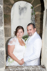 a plump woman and man bride and groom in wedding day