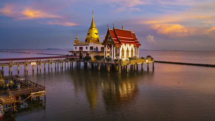 Beautiful Wat Hong Thong located in a mangrove forest area , magnificient temple on the sea in sunset , Bang Pakong District, Chachoengsao ,Thailand