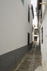 Narrow alley in Albaicin, Granada, Spain