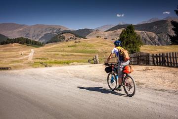 Mountain biker is travelling in the highlands of Tusheti region, Georgia