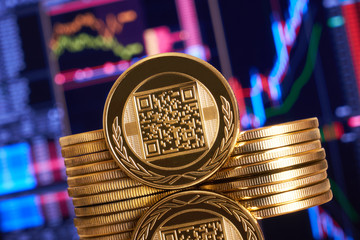 Gold coin bitcoin stacked on a bright background of business graphics close-up. Bitcoin crypto-currency. Anonymous. Virtual currency. BTC