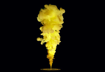 A beautiful bright yellow clot drowns and spreads in the water against a black background.