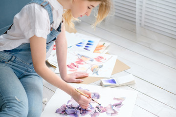 creative art lifestyle. drawing hobby and self expression. young beautiful girl painting a picture at home