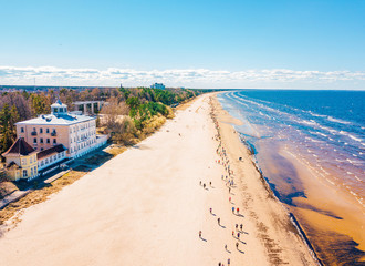 Wall Murals United States Aerial view from drone on crowd of people who is starting are running on marathon event by the sea shore in Jurmala, Latvia.
