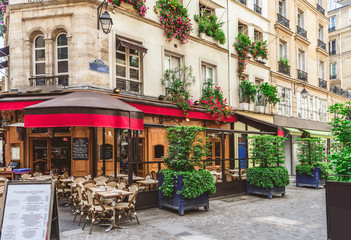 Fototapeten Zentral-Europa Typical view of the Parisian street with tables of brasserie (cafe) in Paris, France