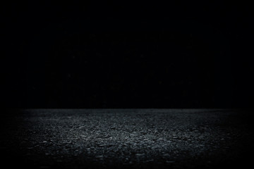 Spotlight on concrete floor. dark black and glowing lights