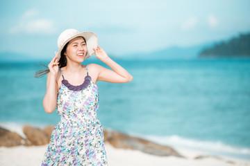 Asian woman enjoying a day at the beach
