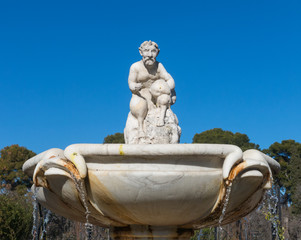 Cupid statue in the fountain of the Garden of Roses in Buen Retiro Park. Madrid