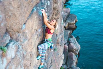 girl climber climbs up.