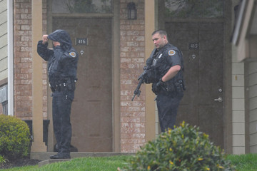 Metro Davidson County police search the apartment complex where Waffle House shooting suspect, Travis Reinking, reportedly lives near Nashville, Tennessee