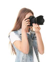 Female photographer with camera on white background