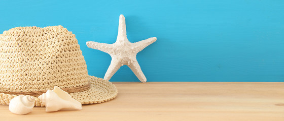 nautical, vacation and travel banner with sea life style objects over wooden table.